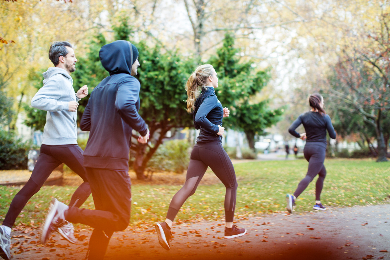 small group running in autumn park