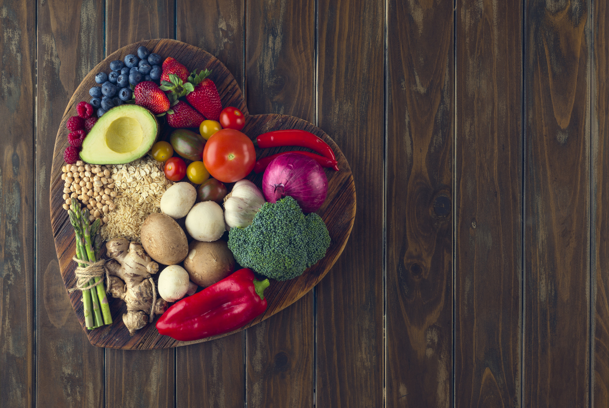 healthy foods on a heart shaped cutting board